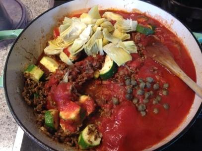 add artichokes, capers and zucchini