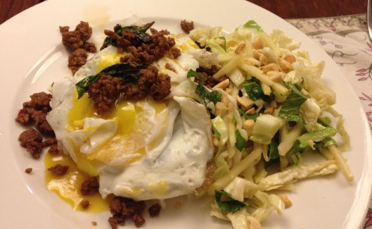 beef with chilli and basil topped with a fried egg