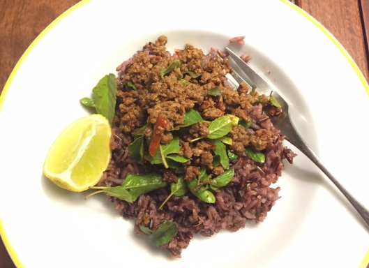 thai stir-fried beef with chilli and holy basil served with purple rice