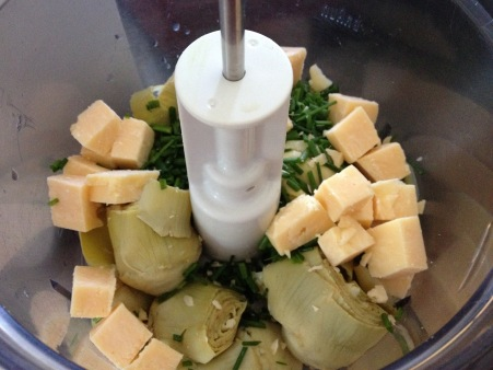 combine artichole, parmesan and chives in processor