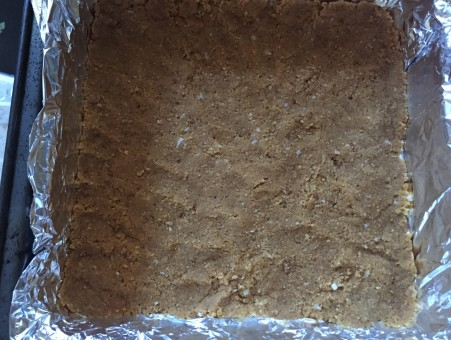 press base into a foil lined pan