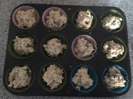 spoon porridge muffin mixture into tin