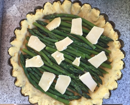 lay asparagus in crust, and top with cheese