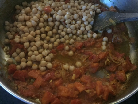 add chickpeas to tomato base