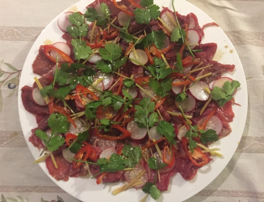 Asian carpaccio with ginger, chilli and radish