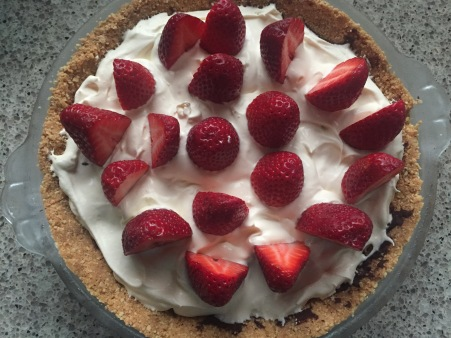 top with halved strawberries
