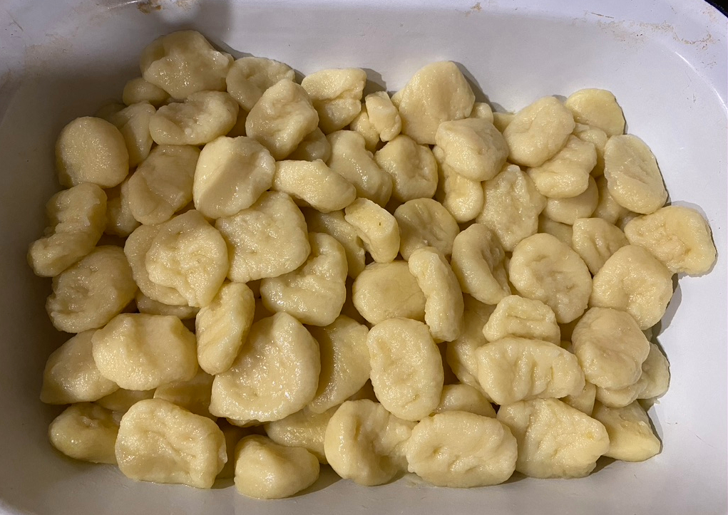 drained gnocchi in a metal dish